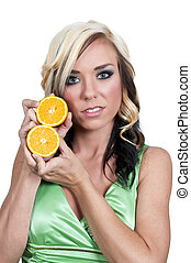 Woman Holding Orange Slices - Beautiful woman holding fresh...