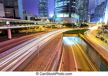 city in night with busy traffic