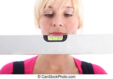 Woman looking at a spirit level