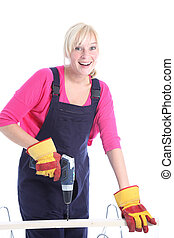 Happy woman doing DIY renovations - Happy woman in dungarees...