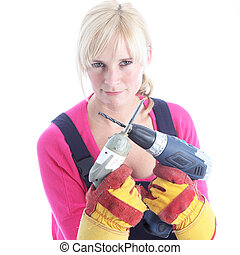 Woman DIY holding power tools - Woman DIY in dungarees and...