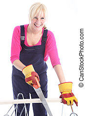 Happy woman cutting timber with a handsaw - Happy woman...