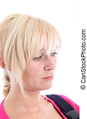 Sad despondent woman with downcast eyes - Studio portrait...