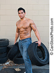 Athlete - Athletic young man with auto tires