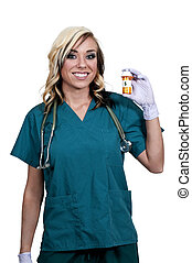 Doctor Holding Pills - A beautiful young female doctor on...