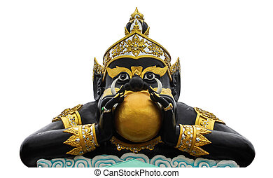 Statue of black deity called Rahu and India god with...
