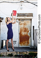Drinking Gasoline - Beautiful woman drinking from a gasoline...