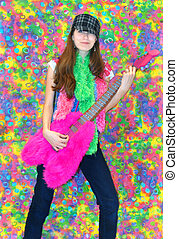 Groovey Guitar Player - Female teen holds a stuffed, furry,...