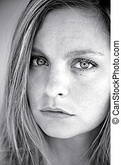 Beautiful serious blonde girl black and white