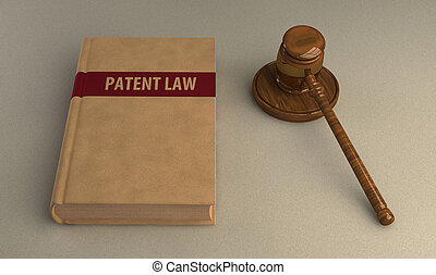 Gavel and patent law book on linen surface. Conceptual...