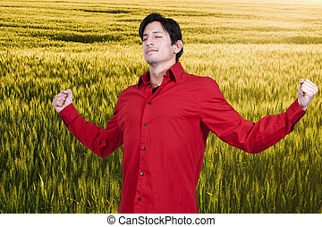 Man with Allergies - Handsome man with allergies in a field