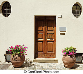 elegant doorway - to the house with terracotta containers...