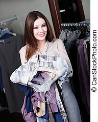 Lovely woman is eager to make purchases - Lovely woman likes...
