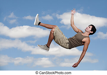 Man Falling Through the Sky - Handsome young man falling...