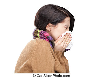 Sneezing young woman holding wipe