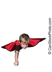 Super Hero - Handsome young boy super hero flying through...