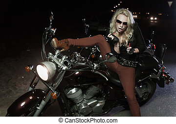 Biker girls - Portrait of biker girl with motorcycle, doing...