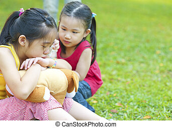 Crying girl - Little girl is comforting her crying sister