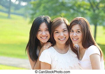 Asian young beautiful friends on vacation day, outdoor park