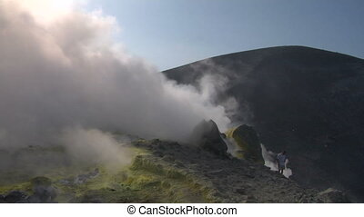 volcano tourist 01 - Tourists walking on an edge of volcano...