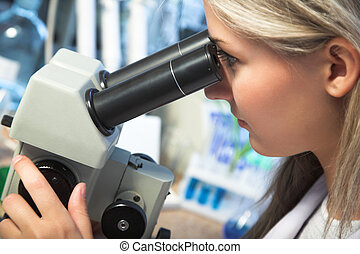 researcher with microscope - beauty researcher looking...