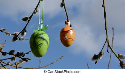 two easter eggs on willow branch