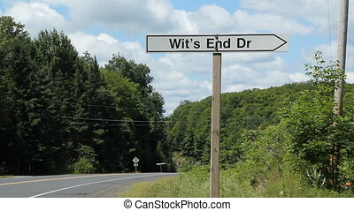 Wits End Drive - Road sign with the name Wits End Drive on...