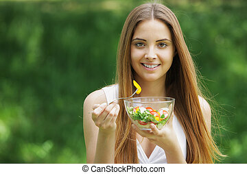 Healthy woman eating salad - Close-up of happy beautiful...