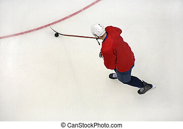 hockey player on ice - hockey player in the sports form with...