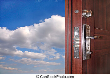 Door - The open door on a background of the bright sky with...