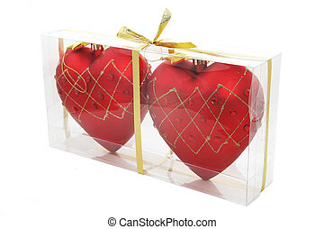 red hearts - Two red hearts in transparent packing