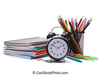 Alarm clock, notebook stack and pencils. Schoolchild and...
