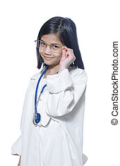 Child playing doctor - Nine year old girl playing doctor...