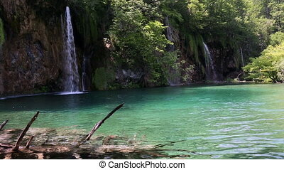 Beautiful waterfall and small pure transparent lake Plitvice...