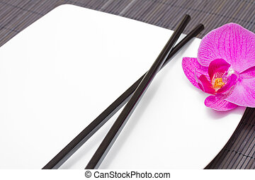 asian food concept - empty plate with chopsticks