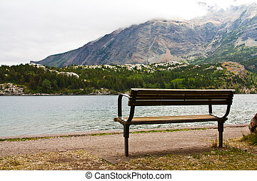 Park Bench at the Lake - an empty bench at a mountain lake