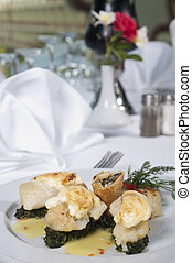 Fish and spinach a la carte meal - Main meal of fish and...