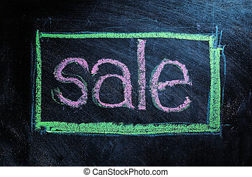 Sale handwritten with white chalk on a blackboard
