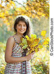 girl with oak leaves posy - Outdoor portrait of girl with...