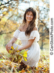 long-haired girl with oak posy in autumn