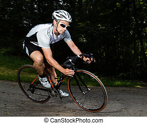cyclist driving through a curve