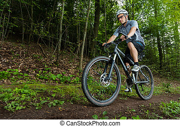 mountainbiker in a worm eyes view