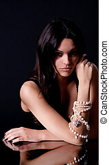 woman with pearl beads - Portrait of beautiful young woman...
