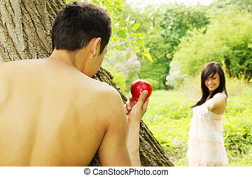 paradise apple - Adam holds out an apple to Eve