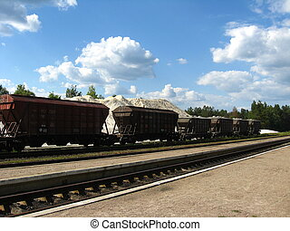 The cars of a freight train - Loading of quartz sand in cars...