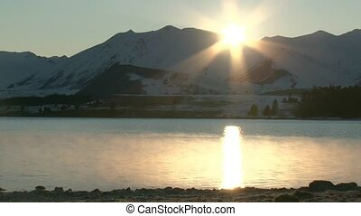 sunrise over Lake Tekapo - Sunrise with shimmering...