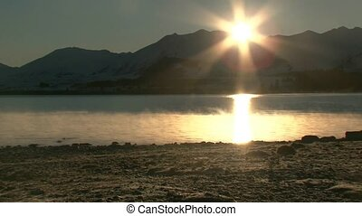 Sunrise over lake Tekapo 2 - Sunrise with shimmering...