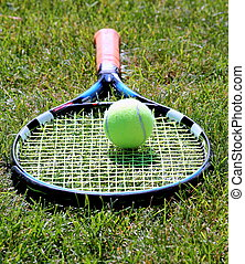 Tennis racket on grass court