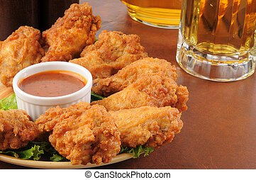 Chicken wings and beer - A plate of chicken wings iwth...