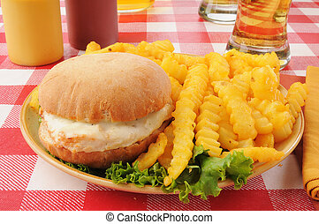 Chicken burger with fries and beer